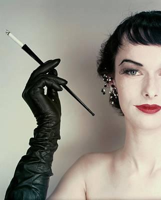 Photograph - Victoria Von Hagen Holding A Cigarette Holder by Erwin Blumenfeld