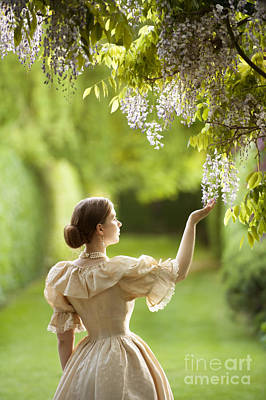Wisteria In Bloom Photograph - Victorian Woman In A Garden With Wisteria Flowers by Lee Avison