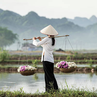 Photograph - Vietnamese Woman Carrying Baskets Of by Martin Puddy