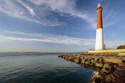 View Of A Red And White Lighthouse Art Print by George Oze