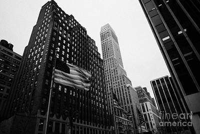 view of pennsylvania bldg nelson tower and US flags flying on 34th street from 1 penn plaza nyc Art Print by Joe Fox