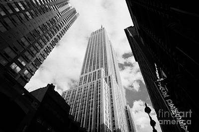 View Of The Empire State Building And Surrounding Buildings And Cloudy Sky West 33rd Street New York Art Print by Joe Fox