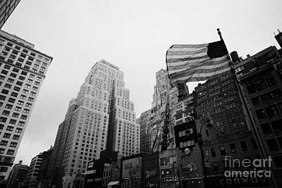 view of US flag flying on 34th street from 1 penn plaza new york city usa Print by Joe Fox