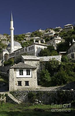 views of pocitelj in Bosnia Hercegovina with minaret bridge and river Art Print
