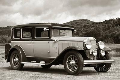 Antique Automobiles Photograph - Vintage Automobile On Dirt Road by Olivier Le Queinec