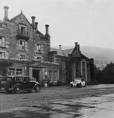 Photograph - Vintage Cars In Front Of Hotel by John Mcmullin