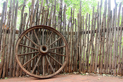 Rolled Yard Photograph - Vintage Wagon Wheel And Log Fence by Adam Long
