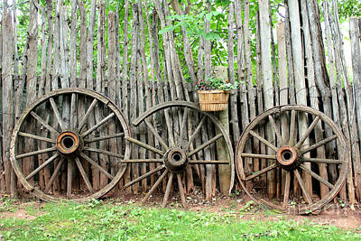 Rolled Yard Photograph - Vintage Wagon Wheels And Rustic Log Fence by Adam Long