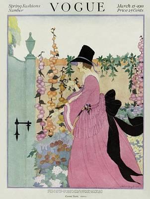 1918 Photograph - Vogue Cover Featuring A Woman Gardening by Helen Dryden