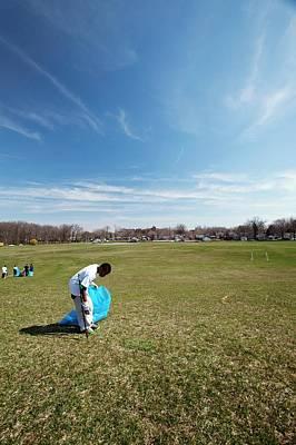 Volunteers Clearing Park Litter Art Print by Jim West