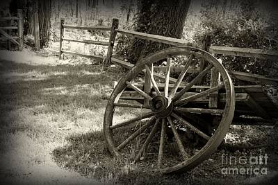 Antique Wagons Photograph - Wagon Wheel  by Paul Ward
