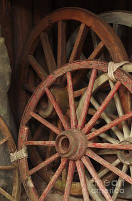 Wooden Farm Wagon Photograph - Wagon Wheels by Carlos Caetano