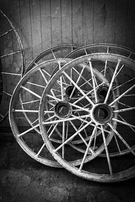 Wagon Wheels Photograph - Wagon Wheels In Black And White by Debra and Dave Vanderlaan