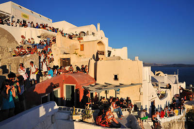View Photograph - Waiting For The Sunset In Oia Town by George Atsametakis