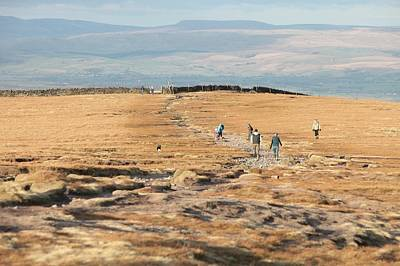 Walkers Near The Summit Of Pendle Hill Print by Ashley Cooper