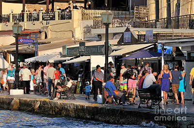 Photograph - Walking In The Old Port Of Chania by George Atsametakis