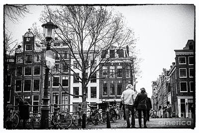 Photograph - Walking Through Amsterdam by Patricia Hofmeester