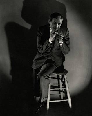 Walter Winchell Lighting A Cigarette Art Print by Edward Steichen