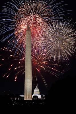 Washington Monument And U.s.capitol Under Fireworks Art Print by Regina  Williams