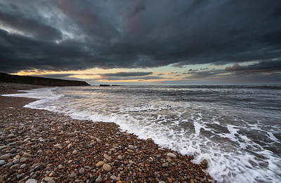 Storm Clouds Sunset Twilight Water Photograph - Water Coming Up On The Shore by John Short