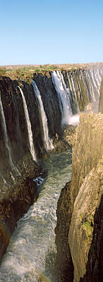 Zimbabwe Photograph - Water Falling Through Rocks In A River by Panoramic Images