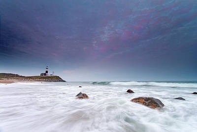 Montauk Point Lighthouse Photograph - Water Floods The Rocky Shore In Front by Robbie George