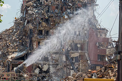 Water Spraying At Demolition Site Art Print by Jim West