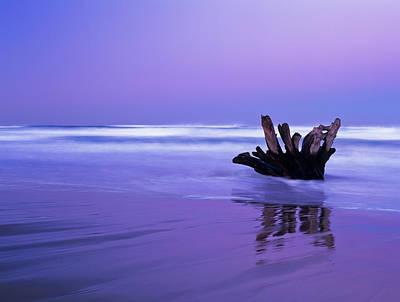 Waves Break On The Beach At Dawn Art Print
