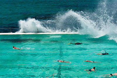 Medium Group Of People Photograph - Waves Breaking Over Edge Of Pool by Panoramic Images