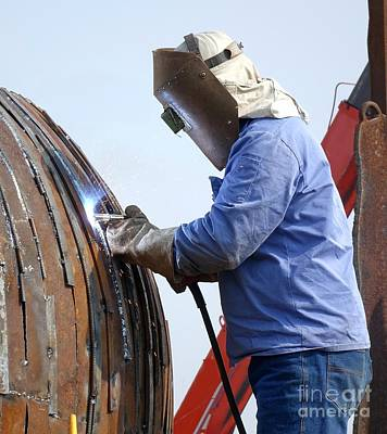 Arc Welder Photograph - Welder At Work Using The Shielded Metal Arc Process by Yali Shi