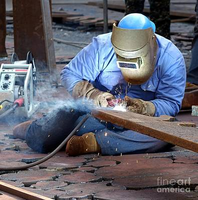 Photograph - Welder Using The Shielded Metal Arc Process by Yali Shi