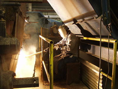 Photograph - Welding In A Louisiana Sugar Mill by Ronald Olivier