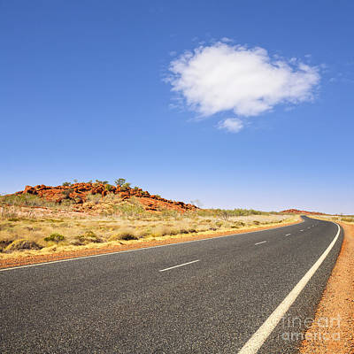 Western Australia Pilbara Region Never Ending Long Curving Road  Art Print by Colin and Linda McKie