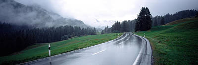 Wet Highway Passing Through A Forest Print by Panoramic Images