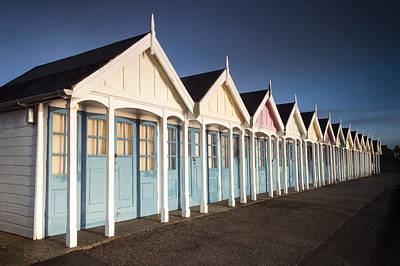 Weymouth Beach Huts Print by Chris Frost