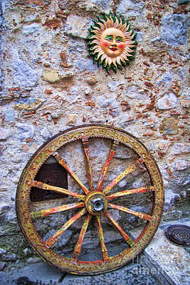 Wheel And Sun In Taromina Sicily Art Print by David Smith