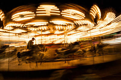 Whirling Carousel With Rider Print by Aaron Baker
