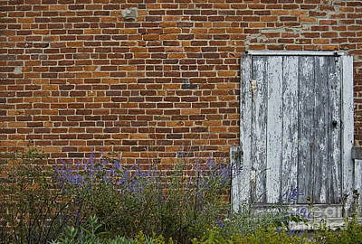 Photograph - White Door In Brick Building by David Arment