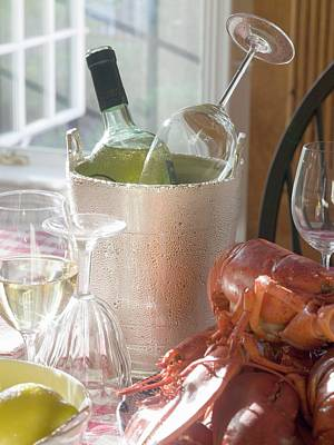White Wine Bottle In Ice Bucket, Wine Glasses, Lobster, Lemon Art Print