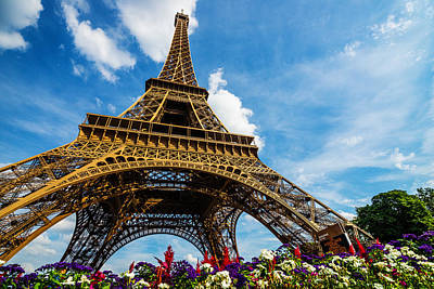 Photograph - Wide Shot Of Eiffel Tower With Dramatic Sky And Flowers by Gurgen Bakhshetsyan