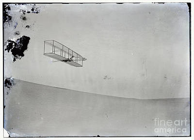 Photograph - The Wright Brothers Wilbur Gliding Down Steep Slope Of Big Kill Devil Hill by R Muirhead Art