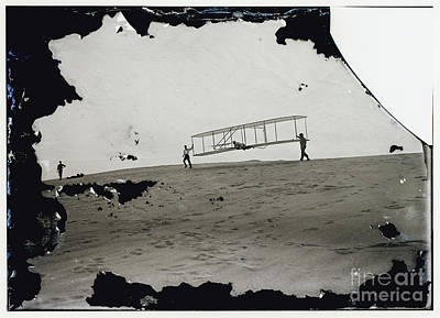 Photograph - The Wright Brothers Wilbur In Motion At Left Holding One End Of Glider by R Muirhead Art