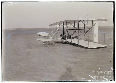 Photograph - The Wright Brothers Wilbur In Prone Position In Damaged Machine by R Muirhead Art