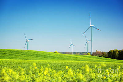Electricity Photograph - Wind Turbines On Spring Field by Michal Bednarek