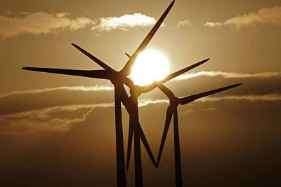 Wind Turbines Silhouette Against A Sunset Art Print