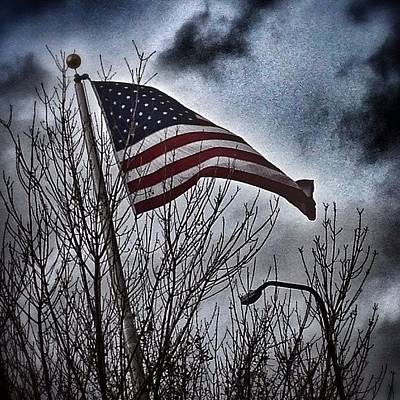 Photograph - Wind Whipped Flag by Kathleen Messmer