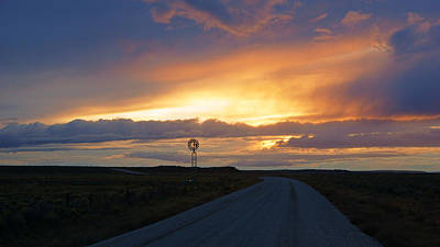 Photograph - Windmill At Sunset On Dirt Road by Daniel Woodrum