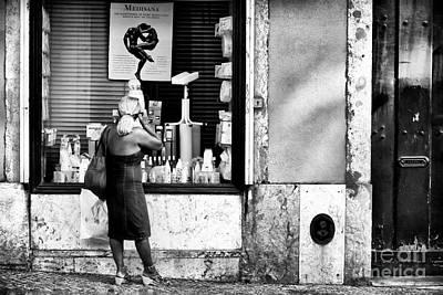Photograph - Window Shopping In Lisbon by John Rizzuto