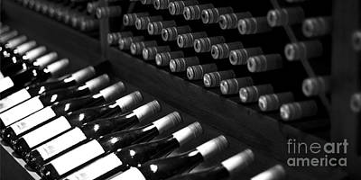 Wine Bottles On A Rack At A Winery Near The Vineyards Art Print by ELITE IMAGE photography By Chad McDermott