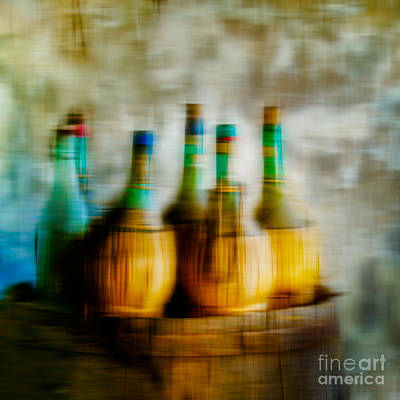 Of Wine Bottles Photograph - Wine On A Barrel  by Emilio Lovisa